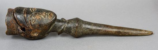 An African carved wooden tribal staff Of short proportions, the top carved with a head.  47.