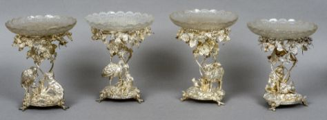 A set of four 19th century silver plated table centres, published by Elkington & Co.