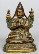 A small painted and patinated bronze model of Buddha Seated in the lotus position wearing a