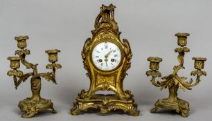 A 19th century three piece gilt bronze clock garniture Decorated in the rococo manner.