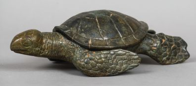 A patinated bronze model of a turtle The removable shell revealing a recess.  34 cm long.