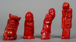 Four various Chinese carved coral figures The largest 9 cm high.