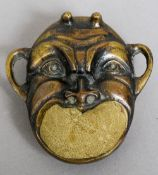 A 19th century bronze pin cushion Formed as a devil mask.  8.5 cm high.
