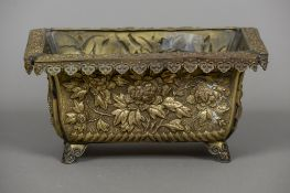 A 19th century Japanese repousse decorated planter The lappet set border above panels decorated