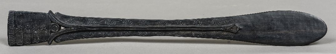 A tribal lime spatula, possibly Trobrian Islands With scrolling carved decoration. 55 cm long.
