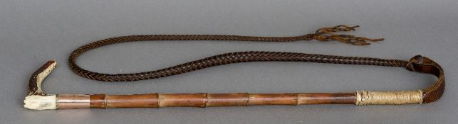 A gold collared antler handled riding crop Of typical form, the collar marked for Swaine & Adney.