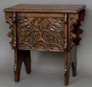 A late 19th/early 20th century carved oak boarded box stool With rectangular hinged lid above a