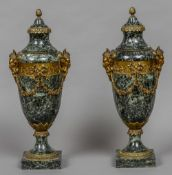 A pair of 19th century variegated green marble ormolu mounted urns With applied satyr masks and