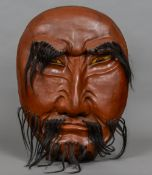 A large late 19th century Japanese lacquered mask of Noh Of typical form,