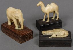 Three small carved ivory models of animals, possibly Indian An elephant, a camel and a crocodile,