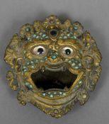 A Tibetan gilt decorated censor Formed as a three eyed mythical beast,