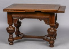 An 18th century Dutch oak drawer leaf table The cleated rectangular top above the carved frieze,