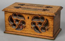 A 19th century oak correspondence box The hinged rectangular cover with apertures labelled Answered