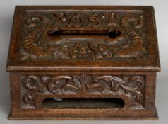 A Victorian carved oak post box The sloping hinged lid inscribed Post above a recess flanked by