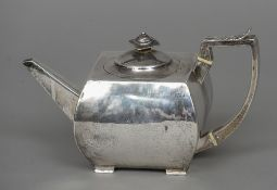 A George III silver tea pot, hallmarked London 1802, maker's mark of IR Of squat square form,