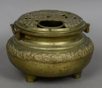 A large Oriental brass censor The removable pierced top cast with flowers,