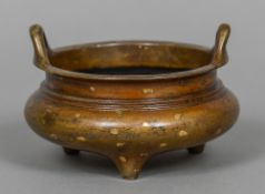 A small Chinese gold splash and patinated bronze censor Of typical twin loop handle squat form with