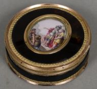 A matched pair of 18th century Continental unmarked gold mounted porcelain inset and enamel
