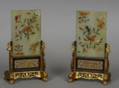 A pair of Chinese hardstone mounted jade table screens Each with floral decorations mounted in gilt