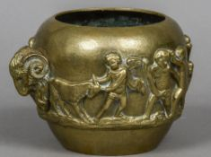 A 19th century Grand Tour brass jardiniere Decorated in the round with putto and cherubs and