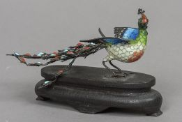 A Chinese unmarked white metal filigree and enamel model of a peacock Typically modelled with