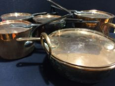 Four antique copper saucepans and covers Together with a copper preserve pan and cover.