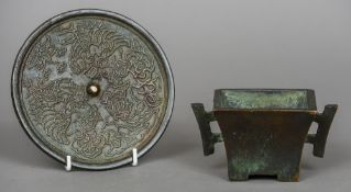 A Chinese patinated bronze censor Of squat flare angular design with twin handles,