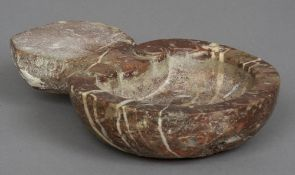 A variegated rouge marble water stoop Of typical form, with scroll carved decoration. 19.5 cm wide.
