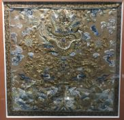 A 19th century Chinese silkwork panel Decorated with dragons and phoenix chasing a flaming pearl,