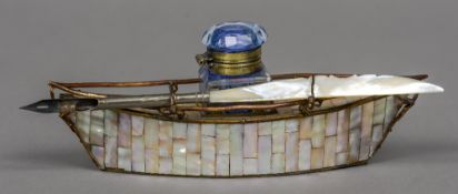 A late 19th century souvenir mother-of-pearl desk stand formed as a boat Inscribed Biarritz;