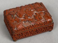 A small late 19th century Chinese cinnabar lacquered box The domed removable cover decorated with