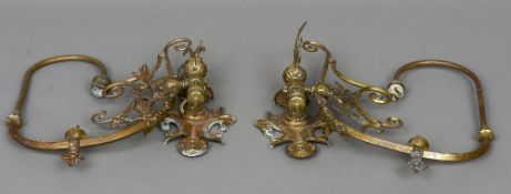 A pair of Victorian brass gas light wall sconces The hinged arm with foliate scroll work.