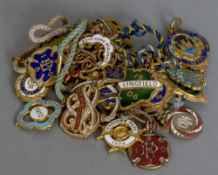 A quantity of vintage enamelled racing badges,