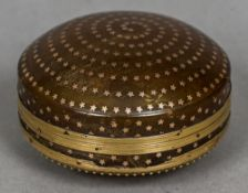 An 18th/19th century gold mounted and pique decorated blond tortoiseshell box and cover Of circular