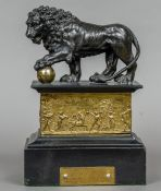 An early 20th century patinated spelter model of a lion Mounted on a slate stepped plinth base