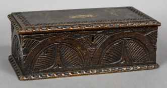 A 19th century carved oak offertory box The hinged rectangular top with coin aperture,