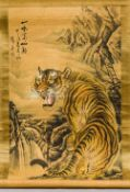 A Chinese painted scroll Worked with a tiger in a mountainous landscape,