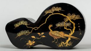 A late 19th/early 20th century Japanese lacquered box The shaped removable lid decorated with an