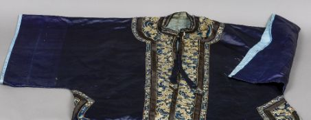 A late 19th century Chinese silk kimono With embroidered floral decoration. 93 cm high.