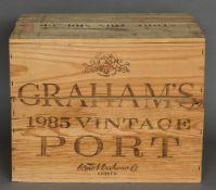 Graham's Vintage Port, 1985 Twelve bottles in old wooden case.