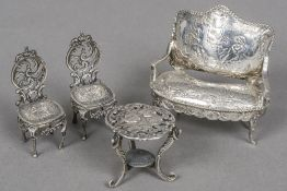 Four pieces of late 19th/early 20th century silver miniature furniture Comprising: a settee with