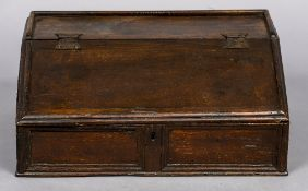 A 17th/18th century oak slope topped Bible box The galleried top above the sloping front with