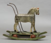 A late 19th/early 20th century painted pine rocking horse The rocking section with bolted removable