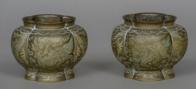 A pair of Chinese brass censors Each of lobed form, engraved with mythical beasts,