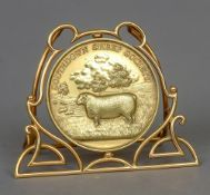 An 18 ct gold Southdown Sheep Society Champion Ram medallion, hallmarked Birmingham 1912,