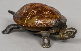 An early 20th century counter bell Formed as a tortoise. 17 cm wide.