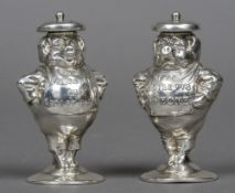 A pair of George V silver novelty pepperettes, hallmarked Birmingham 1911,