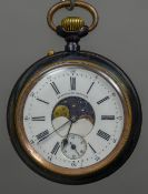 A gun metal cased moonphase pocket watch The white enamelled dial inscribed Calendrier Brevete,