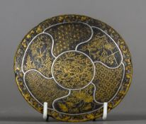 A 19th century Japanese iron dish Of lobed form,