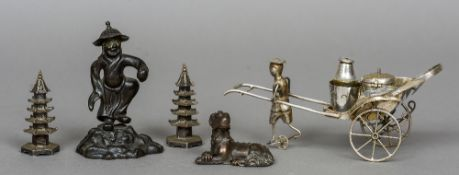 A small collection of Chinese items Including: a pair of silver pagoda form casters,